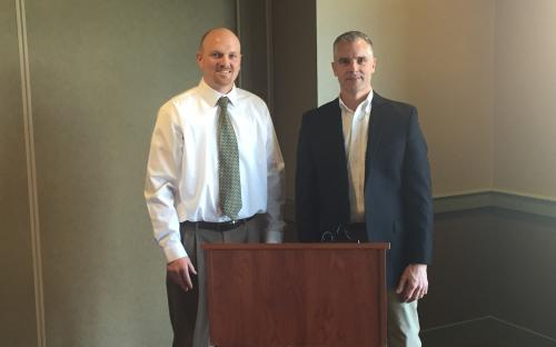Western Michigan CPCU President Beau Barnum and Speaker Kurt Nezwek